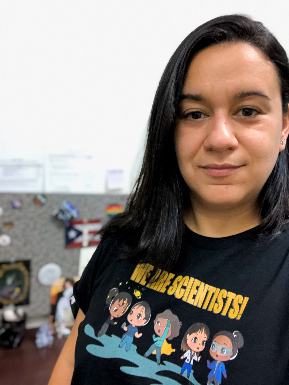 """Semarhy Quinones-Soto wearing a black shirt reading """"We Are Scientists"""""""