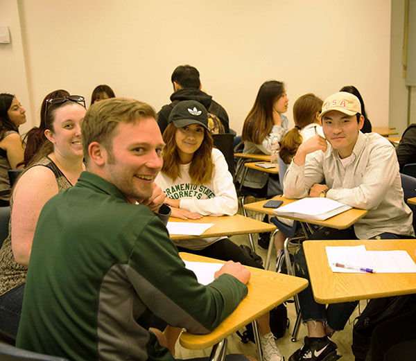 A photo of Sac State and ELI students sitting in a circle during Conversation Club