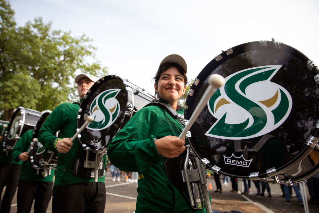 A member of the Sacramento State band during a Homecoming march.