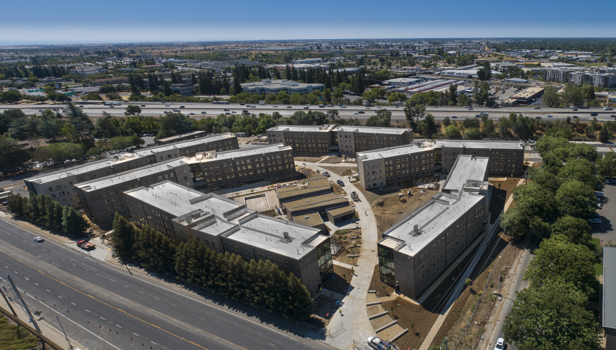 A panoramic view of Hornet Commons, with Highway 50 and the University in the background. (Sacramento State/Rob Neep)